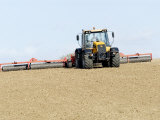 Tractor Rolling a Recently Ploughed Field Near Moreton-In-Marsh  England