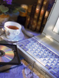 Laptop Computer  Cd-Rom  Cup of Tea  and Books