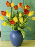Spring Arrangement  Tulipa in Blue Vase Against Green Door