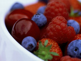 Summer Fruits in White Ceramic Bowl: Strawberries  Raspberries  Blueberries and Cherries