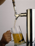 Tap Pouring Beer Into Mug