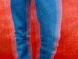 Vibrant Blue Jeans against a Red Background