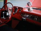 Fuzzy Dice and Cherry Red Interior of a Classic Car