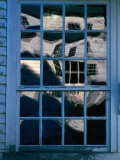 Reflections on the Panes of a Weathered Window