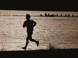 Silhouette of a Jogger Next to Water