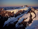 Sunset over Snow-Covered  7 965-Foot-High Mount Olympus