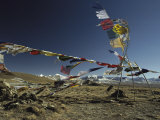 Prayer Flags Blow in the Wind Atop a High Pass on a Tibetan Plateau