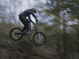 A Boy Flies Through the Air on His Mountain Bike