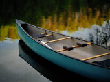 Canoe and Reflections on a Still Lake