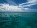 Clouds in Blue Sky over Clear Calm Blue Waters