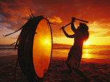 Native Hawaiian Man Beats His Drum on Makena Beach at Sunset Papier Photo par Mark Cosslett