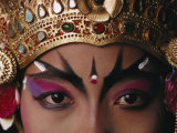 A Close View of a Face of a Balinese Dancer in Costume and Makeup