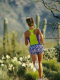 A Woman Runs Through the Desert Landscape