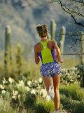 A Woman Runs Through the Desert Landscape