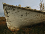 A Wooden Boat Lies Abandoned at the Hay River Shipyard