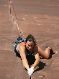 A Young Woman Climbing in Canyonlands National Park  Utah