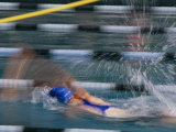 A Swimmer Races Through the Water at a Swimming Competition
