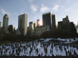 Elevated View of Ice Skaters in Central Park and of the Surrounding Cityscape