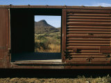 A View of a Distant Hill Through the Door of a Railway Car