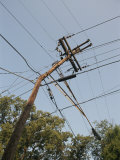 Tangled Wires Stretch in Four Directions from a Telephone Pole