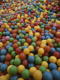 A Rainbow-Colored Landslide of Toy Balls in Abstract Patterns