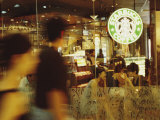 People at One of the First Starbucks Coffee Shops to Open in Beijing