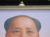 A Person Stands on a Balcony over a Giant Poster of Mao Tse-Tung
