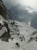 An Extreme Skier in Pas De Chevres Couloir Mount Blanc is in the Background