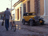 A Man Walks Down the Cobblestoned Street of This Tropical Island  Trinidad  Cuba