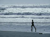 A Person Jogs Along the Beach