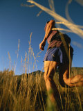 A Man Runs Through Tall Grass Near Mt Elden