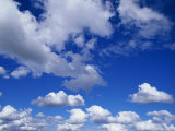 Sunlit Fluffy White Clouds in a Blue Sky