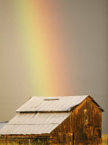 A Rainbow Arches from the Sky onto a Barn