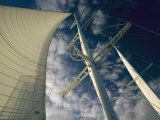 Upward View of a Sailboat with the Mainsail Full of Wind