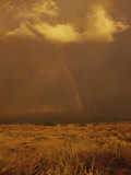Storm Clouds and a Rainbow Appear over the Prairie Landscape
