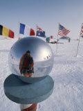 Flags of Many Nations and a Ceremonial Globe at the South Pole