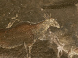 Hunters and Animals in a Cave Painting in the Drakensberg Range