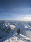 A Man Summits a Mountain in Grand Teton National Park  Wyoming