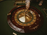 A Patron Spins a Roulette Wheel at a Casino in Monaco