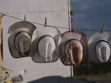 Cowboy Hats Hang on a Clothesline at a Festival in Santa Fe