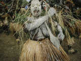 A Dancer at Annual Tribal Sing-Sing Demonstrates the Mourning Ritual of Covering Her Body in Ash