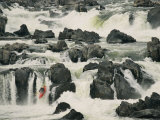 A Kayaker Takes the Last Plunge over a Swift-Flowing Waterfall