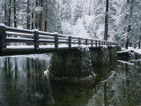 A Snow-Covered Footbridge Spanning the Merced River