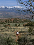 A Runner on the Hidden Valley Trail Above Moab  Utah