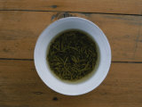 Tea Leaves Steep in a Cup of Hot Water for Green Tea