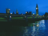 Big Ben and the Houses of Parliament are Seen at Night from Across London Bridge