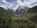View of a Small Village with Mount Everest in the Background