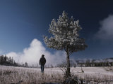 Steam Rises Behind a Man in a Frost-Covered Pocket Basin Field