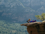 A Hiker Resting at a Cliffs Edge