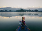 A Woman Stares at the Distant Annapurna Range from a Rowboat